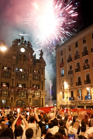 PAMPLONA, SPAIN-JULY 15: People look at fireworks at closing of San Fermin festival. Plaza Consistorial in front of municipality. Pamplona, Navarra, Spain July 15, 2013