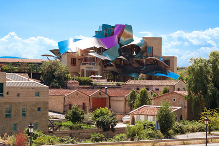 frank gehry: ELCIEGO, SPAIN - AUGUST 15: The modern winery of Marques de Riscal in Elciego, Basque Country, Spain, 2013. Project Frank Gehry, was built in 2007.