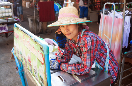 way of living: BANGKOK - DECEMBER 19: A street vendor fast food largest market Khlong Toey in Bangkok, on street Rama IV, December 19, 2013. A common way of earning a living amongst local people in Thailand.