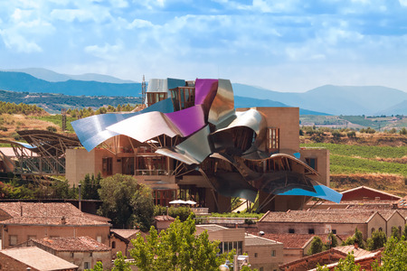 frank gehry: ELCIEGO, SPAIN - AUGUST 15: The modern winery of Marques de Riscal in Elciego, Basque Country, Spain 2013. проект  Frank Gehry, was built in 2007.