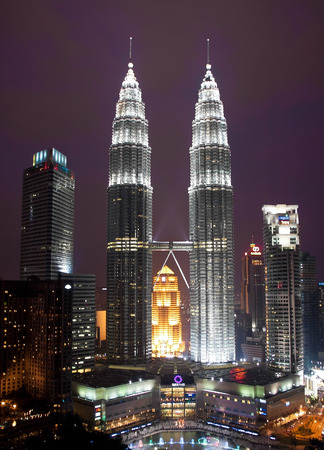KUALA LUMPUR, MALAYSIA - JANUARY 17: Petronas Twin Towers at day on January 17, 2014 in Kuala Lumpur. Petronas Twin Towers were the tallest buildings (452 m) in the world from 1998 to 2004