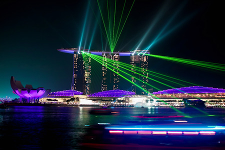 SINGAPORE - JANUARY 24: Marina Bay Sands hotel at night on January 24, 2014 in Singapore. Wonderful show is the largest light and water spectacle in Southeast Asia