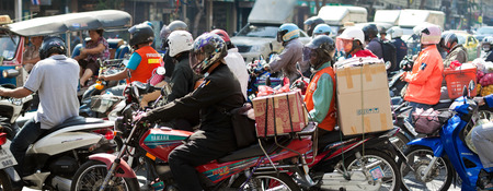 BANGKOK - DECEMBER 20: Motorcyclists wait at a junction during rush hour on December 20, 2013 in Bangkok, Thailand. Motorcycles are often the transport of choice for Bangkoks heavily congested roads.