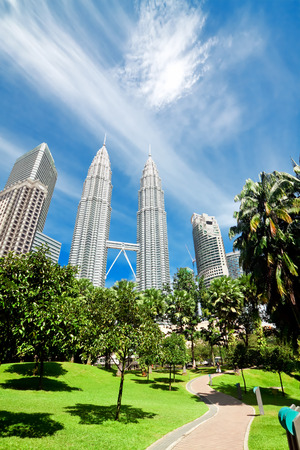KUALA LUMPUR, MALAYSIA - JANUARY 11: Petronas Twin Towers at day on January 11, 2014 in Kuala Lumpur. Petronas Twin Towers were the tallest buildings (452 m) in the world from 1998 to 2004