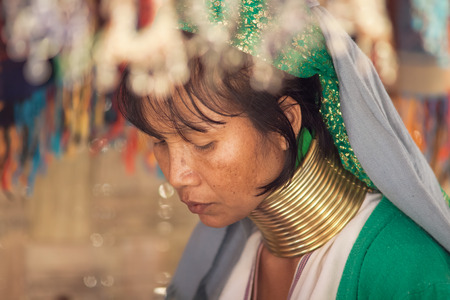 repression: BAN NAI SOI, MAE HONG SON PROVINCE, THAILAND - FEBRUARY 6: Karen tribe woman with rings on neck in Ban Nai Soi, Thailand, February 6, 2014. Repression Karen in Myanmar forced them to flee to Thailand