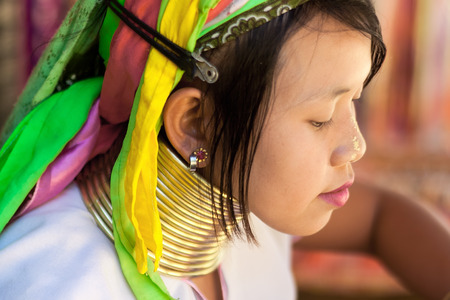 soi: BAN NAI SOI, MAE HONG SON, THAILAND - FEBRUARY 6: Young woman Karen tribe with rings on neck in Ban Nai Soi, Thailand, February 6, 2014. Repression Karen in Myanmar forced them to flee to Thailand