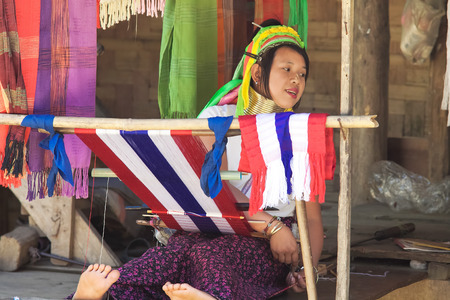 repression: BAN NAI SOI, MAE HONG SON PROVINCE, THAILAND - FEBRUARY 6: Karen tribe woman working at loom in Ban Nai Soi, Thailand, February 6, 2014. Repression Karen in Myanmar forced them to flee to Thailand