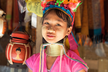 repression: BAN NAI SOI, MAE HONG SON, THAILAND - FEBRUARY 6: Young woman Karen tribe with rings on neck in Ban Nai Soi, Thailand, February 6, 2014. Repression Karen in Myanmar forced them to flee to Thailand