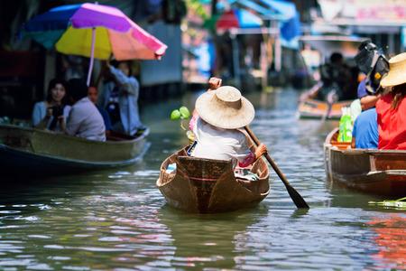 damnoen saduak: saleswoman at Floating Market Damnoen Saduak, Thailand Editorial