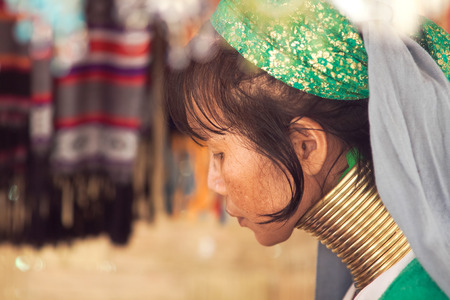 necked woman: BAN NAI SOI, MAE HONG SON PROVINCE, THAILAND - FEBRUARY 6: Karen tribe woman with rings on neck in Ban Nai Soi, Thailand, February 6, 2014. Repression Karen in Myanmar forced them to flee to Thailand