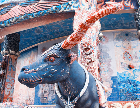 confessor: NAKHONRATCHASIMA PROVINCE, THAILAND - FEBRUARY 20: Sculpture of mythical creatures in temple Ban Rai, Thailand, February 20, 2014. Temple is residence of  personal Confessor of king of Thailand