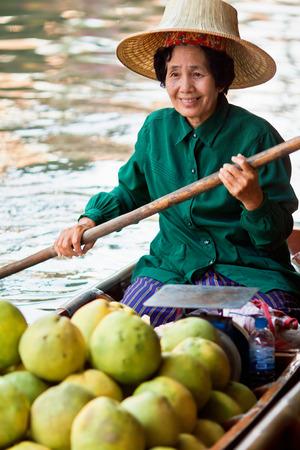 saleswomen: DAMNOEN SADUAK, THAILAND - MARCH 02: Saleswomen at floating markets on March 2, 2014 in Damnoen Saduak, Thailand. Until recently, main form of trade, now mostly a tourist attraction