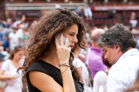 palio: SIENA, ITALY - AUGUST 16: Female in anticipation of start of annual traditional Palio di Siena horse race in medieval square Piazza del Campo August 16, 2014 in Siena, Italy