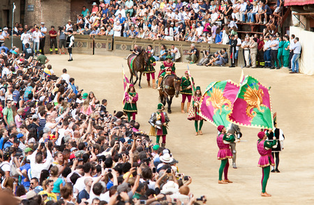 palio: SIENA, ITALY - AUGUST 16: Parade before start of annual traditional Palio di Siena horse race in medieval square Piazza del Campo August 16, 2014 in Siena, Italy