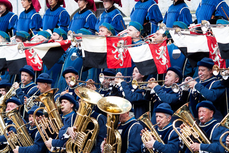 palio: SIENA, ITALY - AUGUST 16: Band on parade before start of annual traditional Palio di Siena horse race in medieval square Piazza del Campo August 16, 2014 in Siena, Italy.