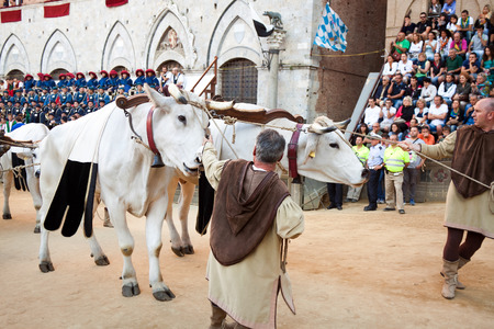 palio: SIENA, ITALY - AUGUST 16: Parade before start of annual traditional Palio di Siena horse race in medieval square Piazza del Campo August 16, 2014 in Siena, Italy. Editorial