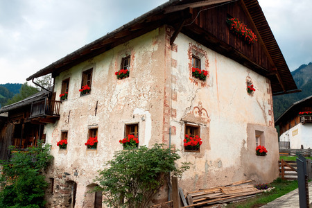 bolzano province: old building in Santa Maddalena village in Dolomites Group, Val di Funes, Italy