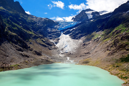 canton berne: Lake and Glacier Trift, view from bridge for hanging in Alps. Canton of Berne. Svitzerland Stock Photo