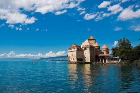 MONTREUX, SWITZERLAND - AUGUST 8: Chillon Castle (Chateau de Chillon) and lake Geneva, Montreux, Switzerland, August 8, 2014. Popular attraction among tourists.
