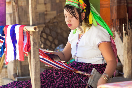 BAN NAI SOI, MAE HONG SON PROVINCE, THAILAND - FEBRUARY 6: Young woman Karen tribe working at loom, Ban Nai Soi, Thailand, February 6, 2014. Repression Karen in Myanmar forced them to flee to Thailand