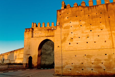 Fortified walls surrounding ancient city of Fes in Morocco