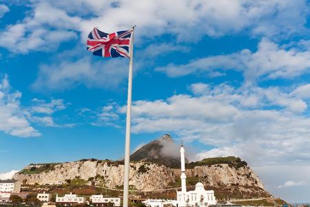 europa: British flag on a background of Ibrahim-al-Ibrahim Mosque at Europa Point, Gibraltar Stock Photo