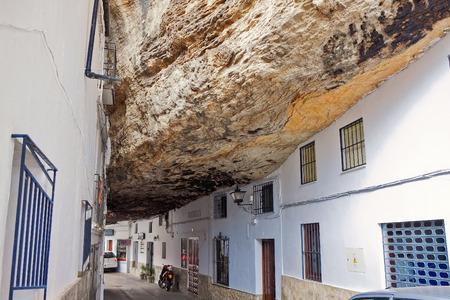 Street with dwellings built into rock overhangs above Rio Trejo. Setenil de las Bodegas, Spain
