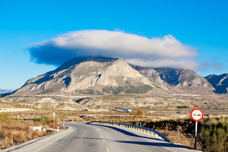 lenticular cloud: Cerro Jabalcon mount and Lenticular cloud near Baza. Andalusia, Spain Stock Photo
