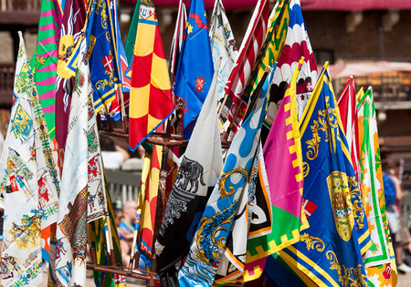 historic world event: Contrada flags on square Campo in Siena, Italy