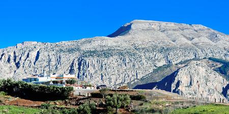 house on hill near Royal Trail (El Caminito del Rey) in gorge Chorro, Malaga province, Spain