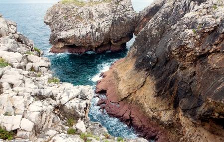 coastal cliffs near beach Gulpiyuri, Asturias, Spain Standard-Bild