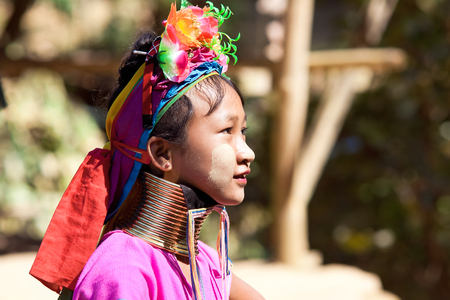 BAN NAI SOI, MAE HONG SON, THAILAND - FEBRUARY 6: Young woman Karen tribe with rings on neck in Ban Nai Soi, Thailand, February 6, 2014. Repression Karen in Myanmar forced them to flee to Thailand