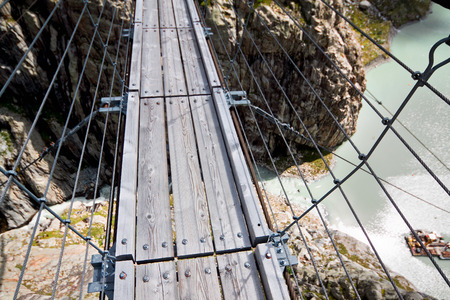 canton berne: Trift Bridge, pedestrian-only suspension bridge in Alps. Canton of Berne. Switzerland Stock Photo