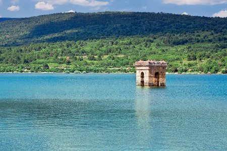 long  ago: destruction of old bell tower of submerged village Muedra  formation of reservoir Pozo on river Diero, Vinuesa, Comarca de Pinares, Soria, Castile and Leon, Spain