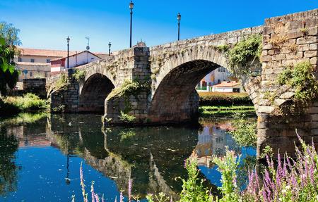 orense: old Roman bridge in Monforte de Lemos, Galicia, Spain