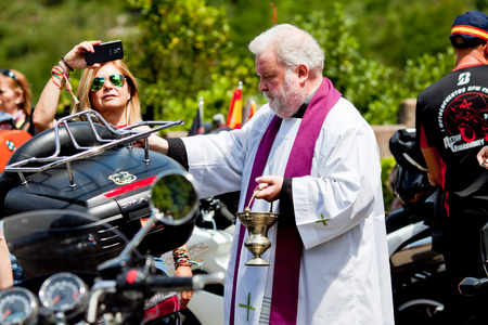 COVADONGA, Spain - July 3, 2015: A pilgrimage of bikers to the Basilica of Santa Maria. In Covadonga began the Reconquista. Priest the blessing of the bikes bikers. Stock Photo - 47605545