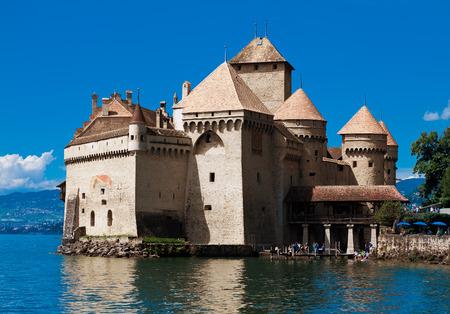 convict lake: MONTREUX, SWITZERLAND - AUGUST 8: Chillon Castle (Chateau de Chillon) and lake Geneva, Montreux, Switzerland, August 8, 2014. Popular attraction among tourists.