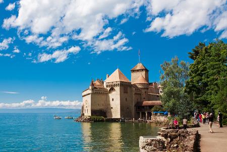 montreux: MONTREUX, SWITZERLAND - AUGUST 8: Chillon Castle (Chateau de Chillon) and lake Geneva, Montreux, Switzerland, August 8, 2014. Popular attraction among tourists.