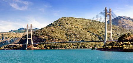 LUNA: modern suspension bridge across river Luna and reservoir Los Barrios de Luna between Oviedo and Leon. Castile and Leon. Spain.