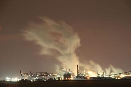 industrial park: Smoking Industrial park at night Stock Photo