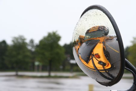 establishment: school yellow bus in convex mirror Stock Photo
