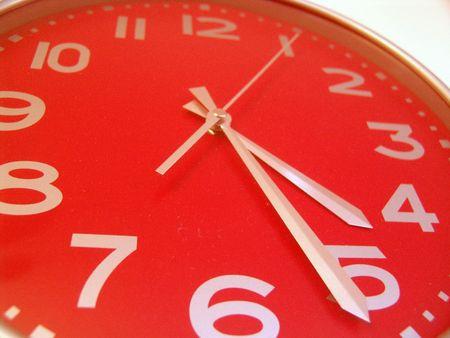 8 12: close-up of a big red clock