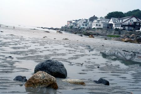 gritty: sand and stones on the beach near a costal town