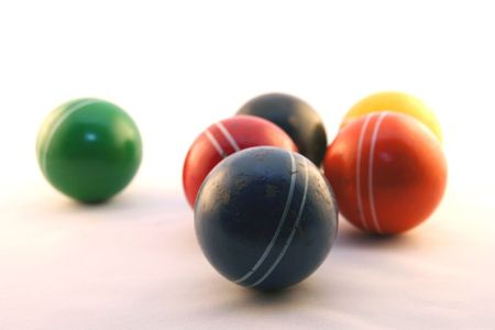 a group of colorful cricket balls on white background