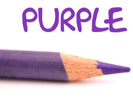 closeup of purple pencil crayon with the word purple above it on white background photo