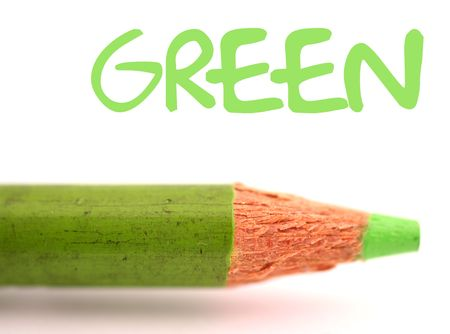closeup of green pencil crayon with the word green above it on white background