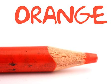 closeup of orange pencil crayon with the word orange above it on white background photo