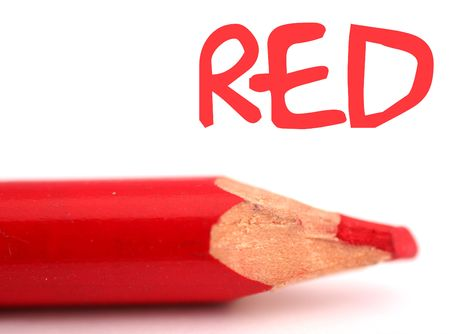 closeup of red pencil crayon with the word red above it on white background Zdjęcie Seryjne