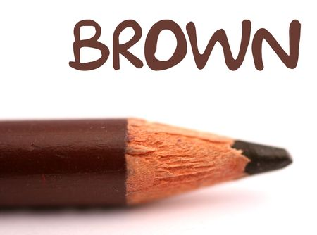 closeup of brown pencil crayon with the word brown above it on white background photo