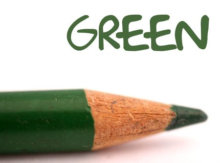 closeup of dark green pencil crayon with the word green above it on white background